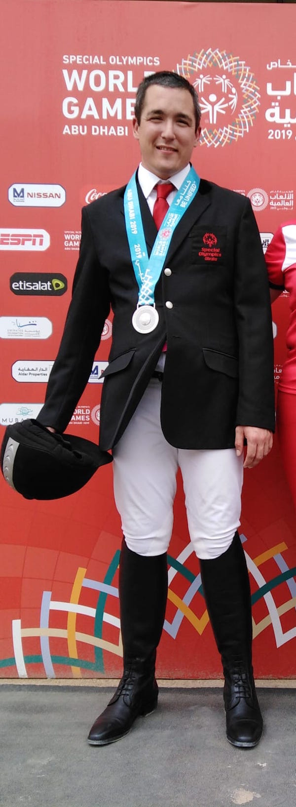 JJ Buttigieg with the first of his 2 silver medals in the equestrian event